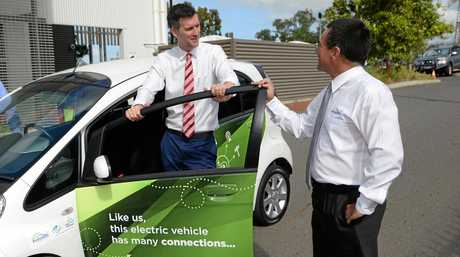 L-R Minister for Energy Mark Bailey and Cr Drew Wickerson with a new electric car provided to Rockhampton Regional Council by Ergon Energy.