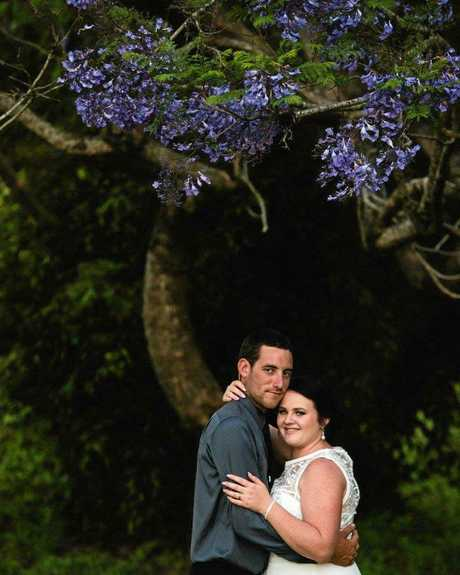 The couple was married in their Andergrove backyard.