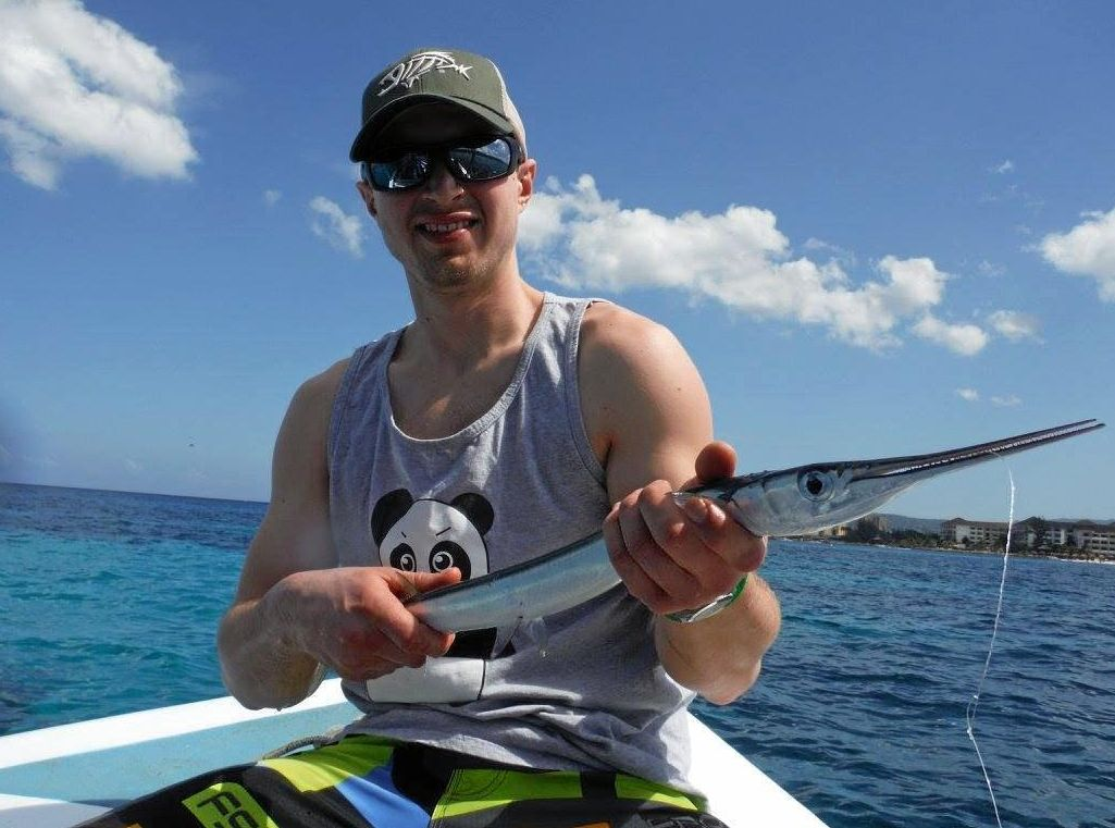 Ryan Janke with a needle fish in Montego Bay, Jamaica.