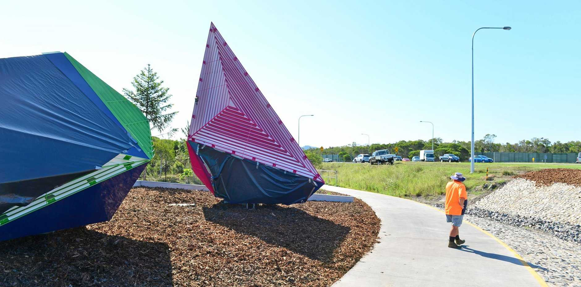 UNDER WRAPS: Graffiti on art installations at the entrance to the newly opened Bells Creek Arterial Road has been covered up.