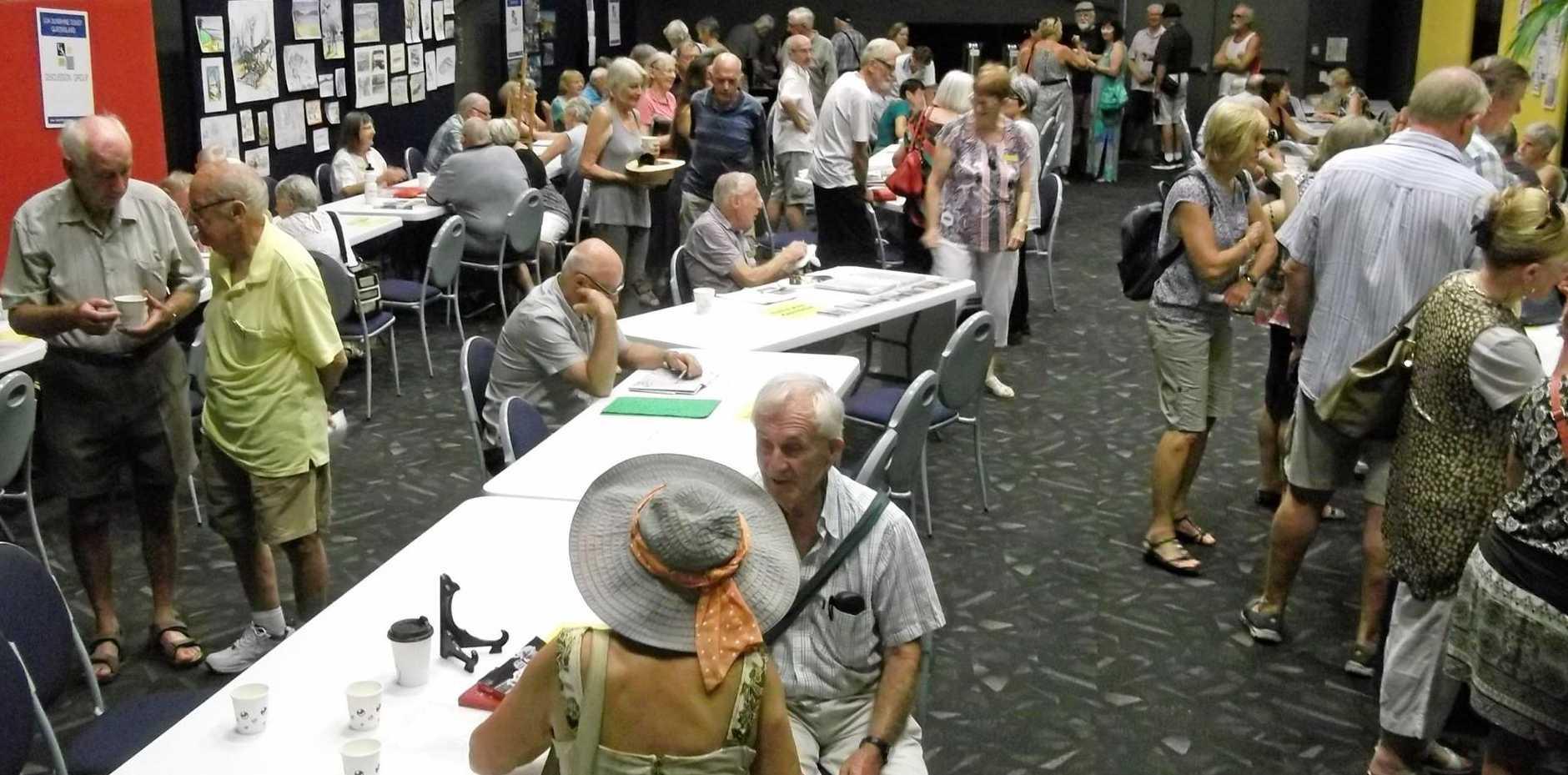 U3A Sunshine Coast tutors discuss courses at the open day.