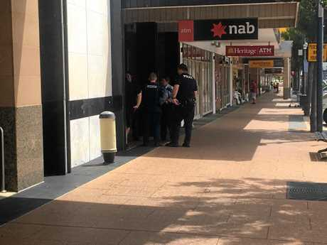 Police and paramedics were on scene outside the NAB branch on Palmerin St where two men had allegedly fought this morning.