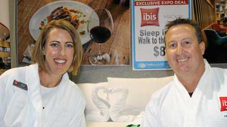 IBIS Mackay assistant manager Natalie Grant and general manager Scott Grant. The husband and wife team, wearing dressing gowns, were manning the hotel's Towel Art display at the helloworld Mackay Travel Expo.