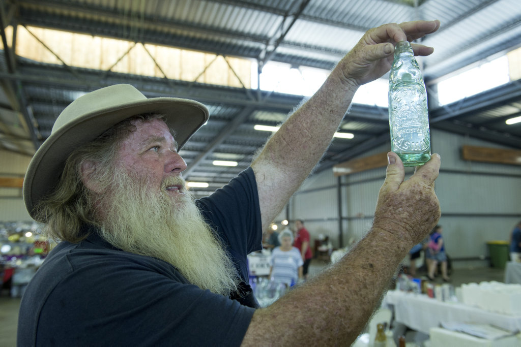 Bottle collector Ray Klein of Roma looks to add to his extensive collection at the Darling Downs Antique Collectables Club Antiques and Collectors Fair and Exhibition at Founders Pavilion, Toowoomba Showgrounds, Saturday, February 18, 2017.