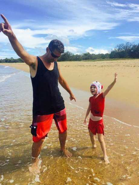 Madeleine and dad Gary Kaddatz mucking around at the beach. Maddie and her family are desperately hoping the drug Orkambi is soon subsidised on the PBS, to address the little girl's chronic cystic fibrosis symptoms.