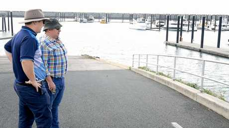 Earthcheck's Nigel Russell (right) and Mackay Regional Council's Michael St Clair inspect the harbour.