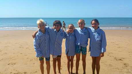 DONNING BLUE: Samuel Biki, Orlando Corrie, Kate Born, Ashley Biki and Klara Close from Mackay Surf Life Saving Club at the State Championships on the weekend.