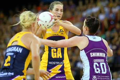 Cara Koenen of the Lightning passes during the round one of the Super Netball match  at Brisbane Entertainment Centre