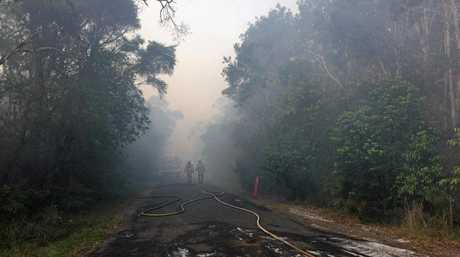 Fire fighters worked around the clock to battle a smouldering blaze north of Lennox Head on Saturday and Sunday.