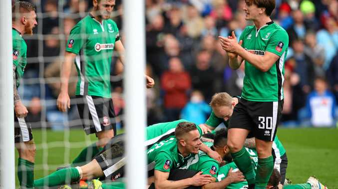 Lincoln City players celebrate Sean Raggett's winning goal in the 1-0 win over Burnley.