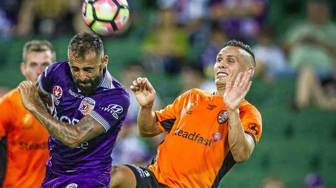Perth Glory's Diego Castro and Jade North of the Brisbane Roar challenge for the ball in the 2-2 draw at nib Stadium.