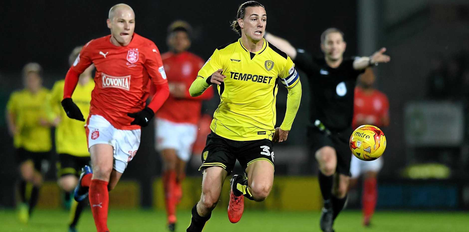 Jackson Irvine of Burton Albion gets past fellow Australian Aaron Mooy of Huddersfield.