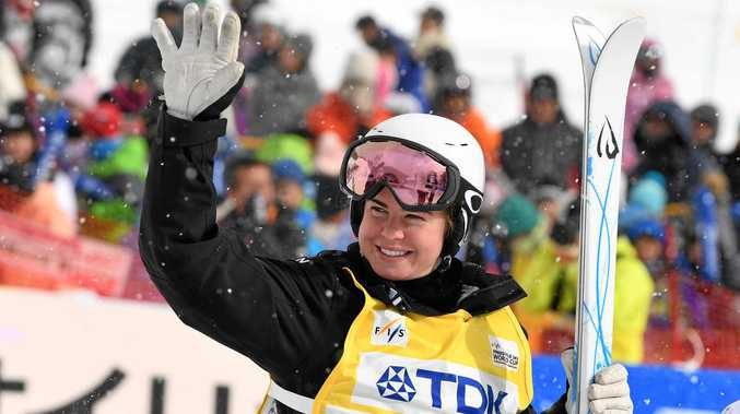 Britteny Cox of Australia celebrates after winning the ladies moguls at Tazawako Ski Resort