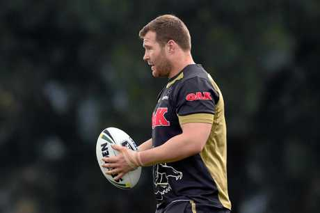 Trent Merrin takes part in a training session