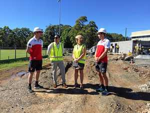 Sydney Swans players Gary Rohan (left) and Dan Robinson run their eye over construction of new changerooms at Fitzroy Oval with AFL (NSW/ACT) State Manager for Diversity, Partnerships and Major Projects, Joseph La Posta and Coffs Harbour City Council Mayor Cr Denise Knight.  Photo: Laura Devoy/Coffs Coast Advocate