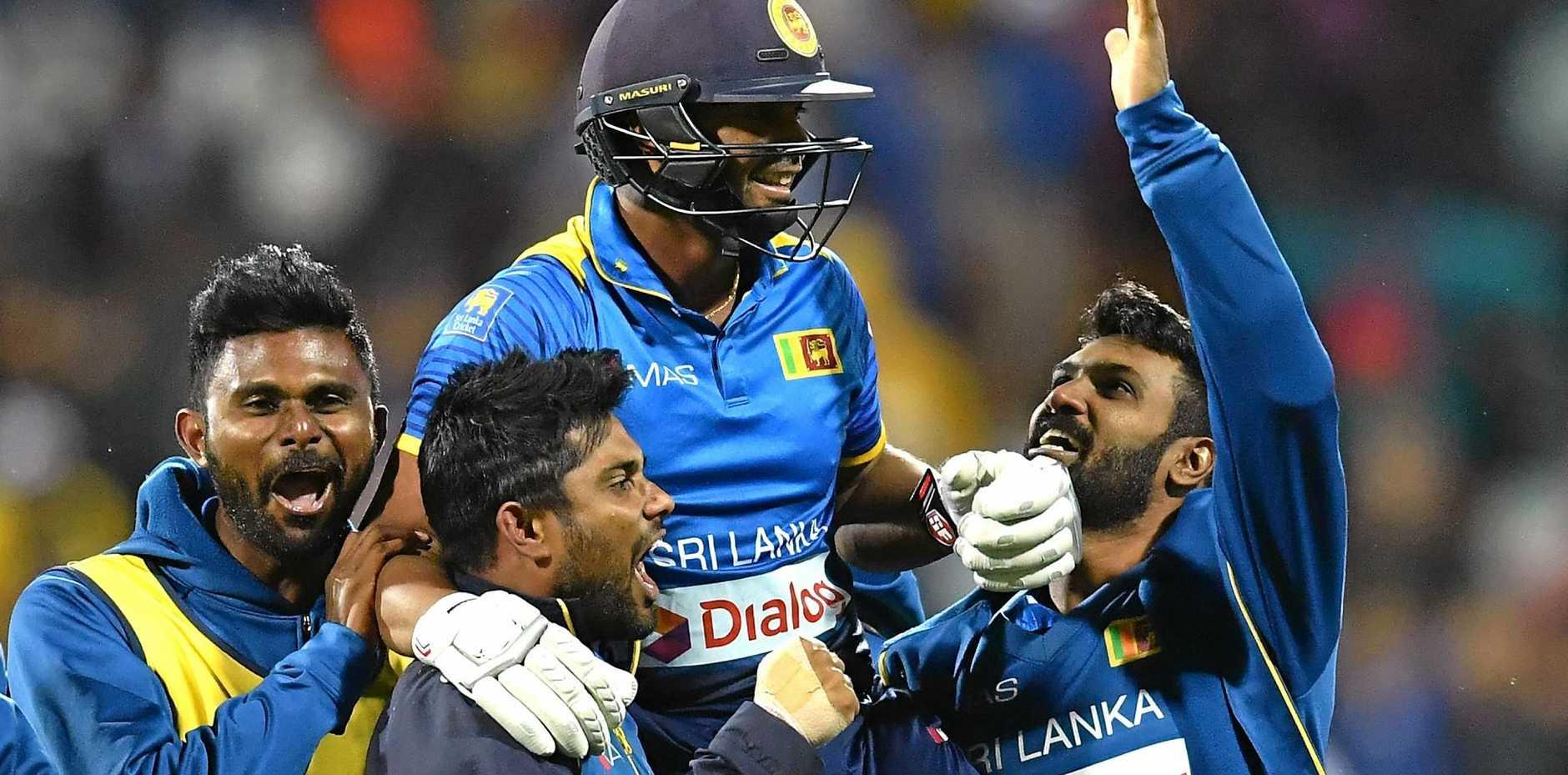 Asela Gunaratne of Sri Lanka is congratulated by teammates after hitting the winning runs to win the second International Twenty20 match between Australia and Sri Lanka at Simonds Stadium.