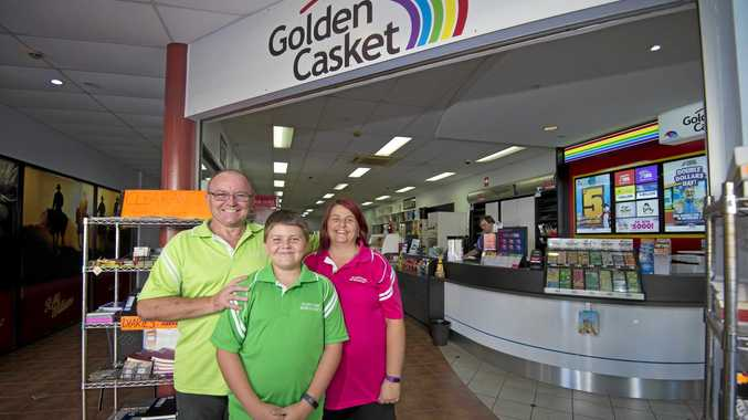 THINKING DIFFERENTLY: Golden Casket Gladstone Newsagency's new owners Andrew and Sonya Sims with their son Jakob, 11. They have plans to put a cafe style area out the back of their store.