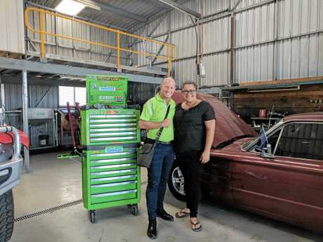 Anton Guinea and Jodie Ahwang from Klaas Diesel, in front of a 1965 Ford Thunderbird.