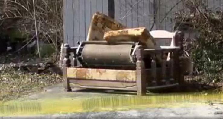Residents had no idea one of their neighbours was living in squalor until emergency vehicles arrived to rescue her. This sofabed is pictured ouside her Ohio home. Picture: WKRN