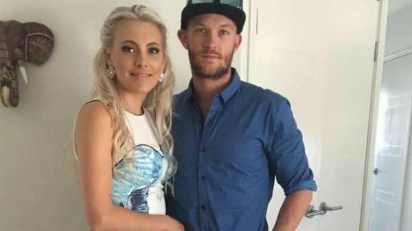 Shark attack victim Glenn Dickson with fiancee Jessie Lee.