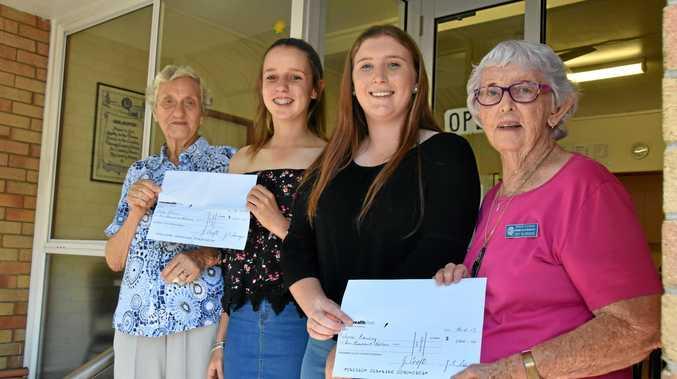 BIG BURSARY: Warwick branch president Jean Croft with bursary recipients Sally Filmer and Melissa Ramsay and QCWA Judy Bilbrough.