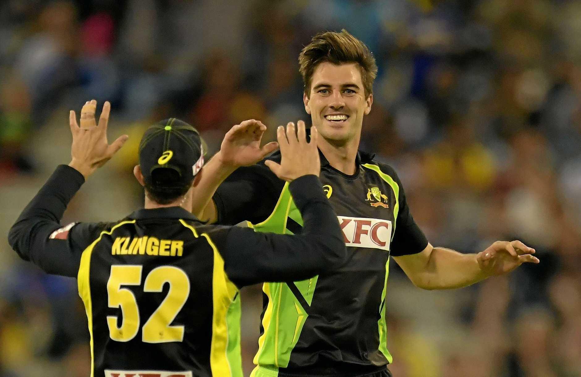 Pat Cummins takes a wicket for Australia