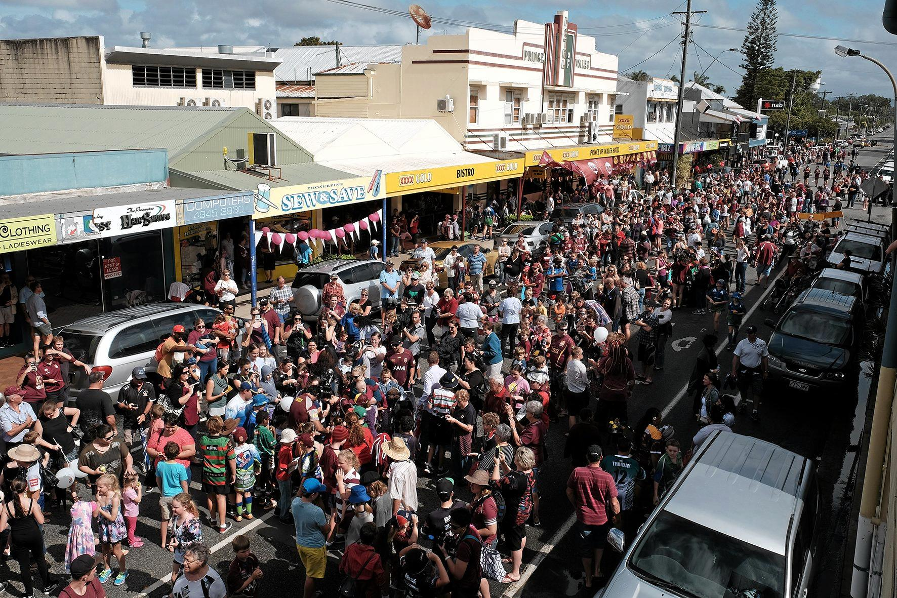 A sea of maroon ran through Proserpine's Main Street for Queensland's regional Fan Day in Proserpine.