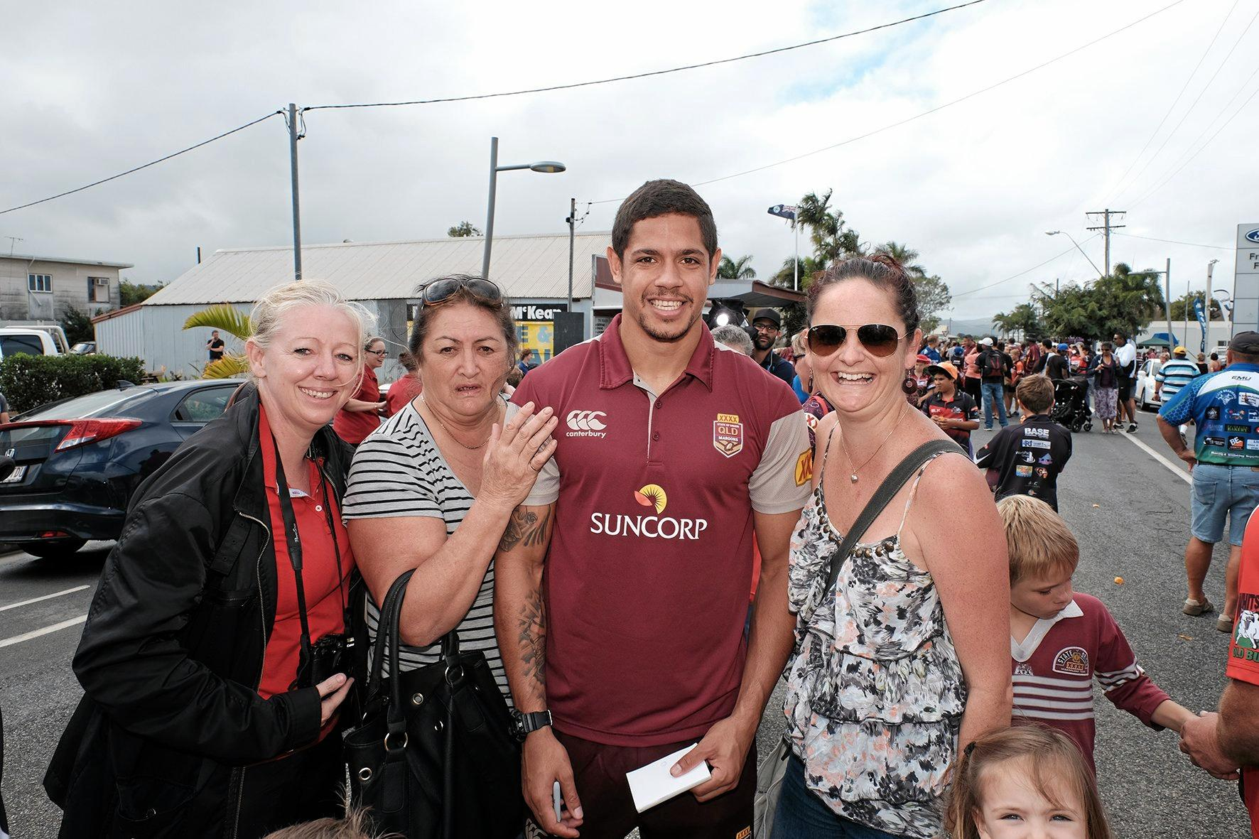 Kerry Martin, Karen Gordon, Dane Gagai and Lauren Squires during the Maroons fan day march in Proserpine.