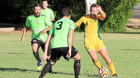Emerald pair Mick Tominich and Shannon Elford close in on the BITS player in their FFA Cup clash last year at Morton Park.