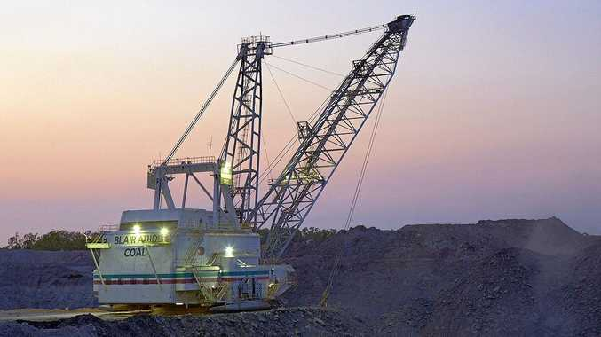 BACK IN ACTION: An electric powered dragline operating at Blair Athol. Production will restart at the mothballed mine.