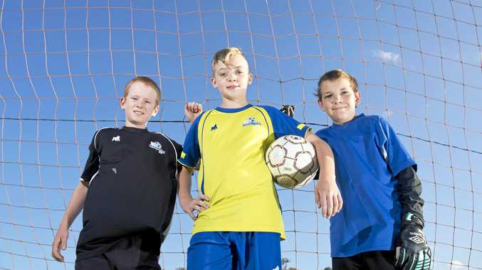 READY: U12 Sam Devlin, Tiaan Engelbrecht and Markus Wheeler are playing for Gladstone as junior soccer starts back up.