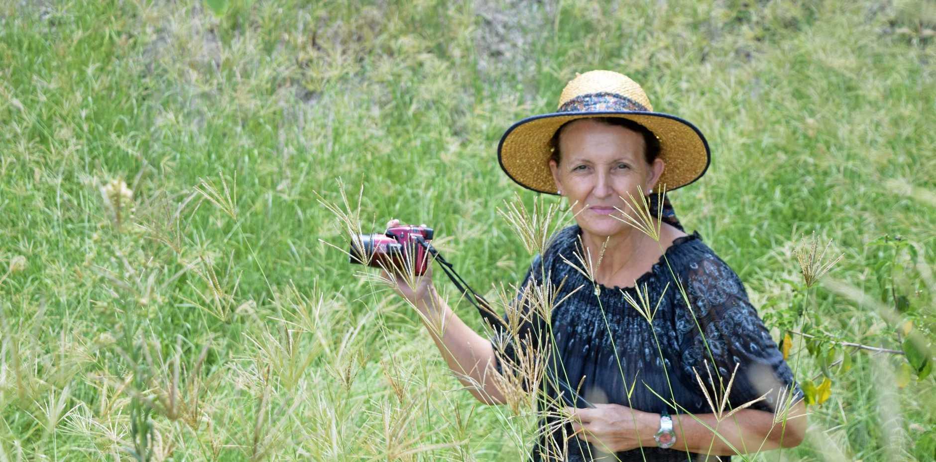 WETLANDS WONDER: Donna Maria Colbrelli-Adams taking photos at the wetlands. LEFT: The Jabiru Geneebeinga sculpture. BELOW: A black rooster at the wetlands.