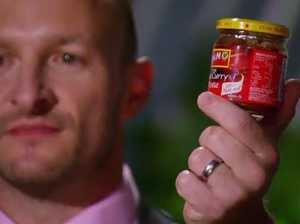 Matt Jenner shows his MKR rivals the curry paste he and Alyse used.