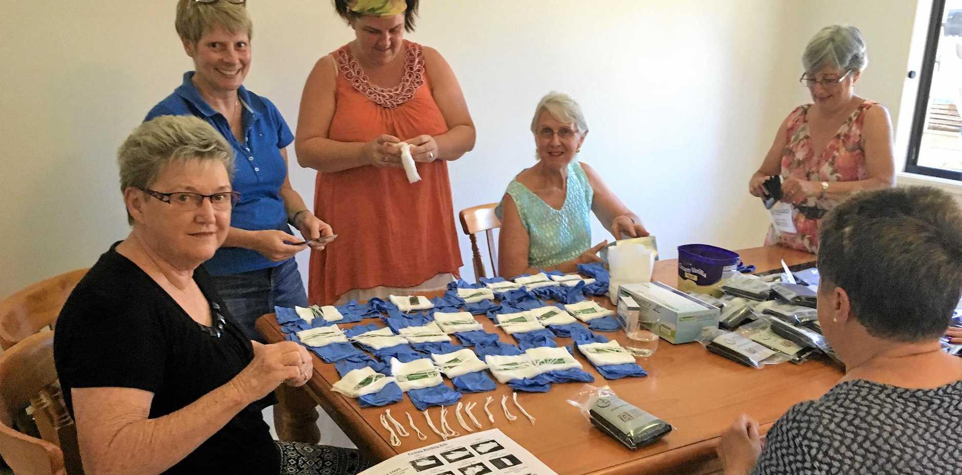 BUSY: Zonta Club of Maryborough members made 400 birthing kits.