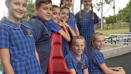 The four sets of South Grafton Public School Year-6 twins, recreating the scene of a kindergarten photo shoot in 2011 at South Grafton Infants School, from back left: Sophi Gaddes, Izac Gaddes, Erin Blundell, Hannah Blundell, Brianna Carney, Taury Carney; (at front) Bessie Dungey and Molly Dungey.