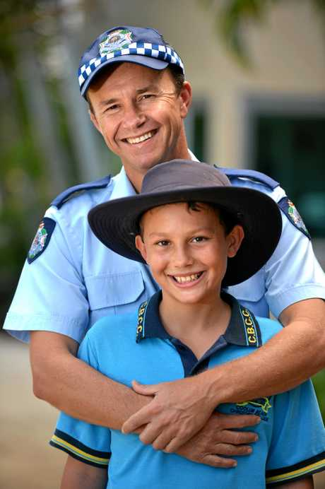 Coolum Police Officer Pierre Senekal and his son Peter who survived liver cancer in 2011. ly