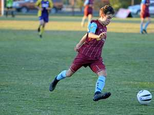 DRIBBLE: Brothers Aston Villa's Nathan Carney in action last season in the Wide Bay League.