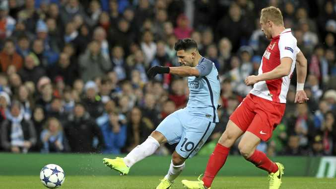 Manchester City's Sergio Aguero scores his side's second goal against Monaco.