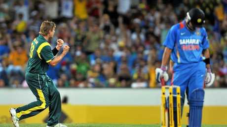Australia's Shane Watson (left) celebrates taking the wicket of Virat Kohli during a ODI in 2012.