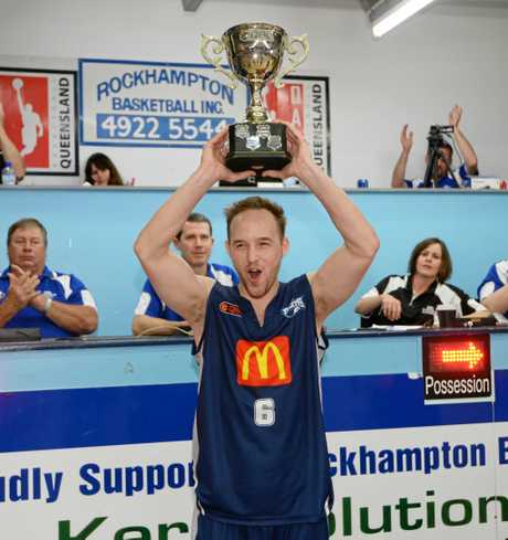 Rockhampton Rockets team captain Mitch Philp with the trophy for winning the QBL basketball grand final against the Mackay Meteors at Hegvold Stadium on Saturday 30 August 2014.   Photo: Chris Ison / The Morning Bulletin