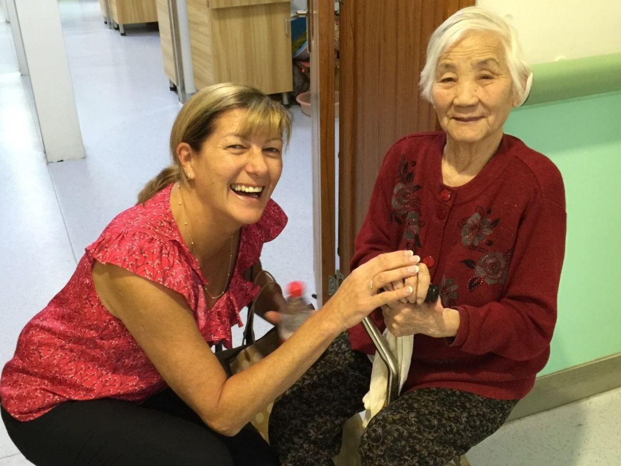 Wesley Mission Queensland's Janet Morghanti in China with a resident of a Chinese Christian Church aged care home.