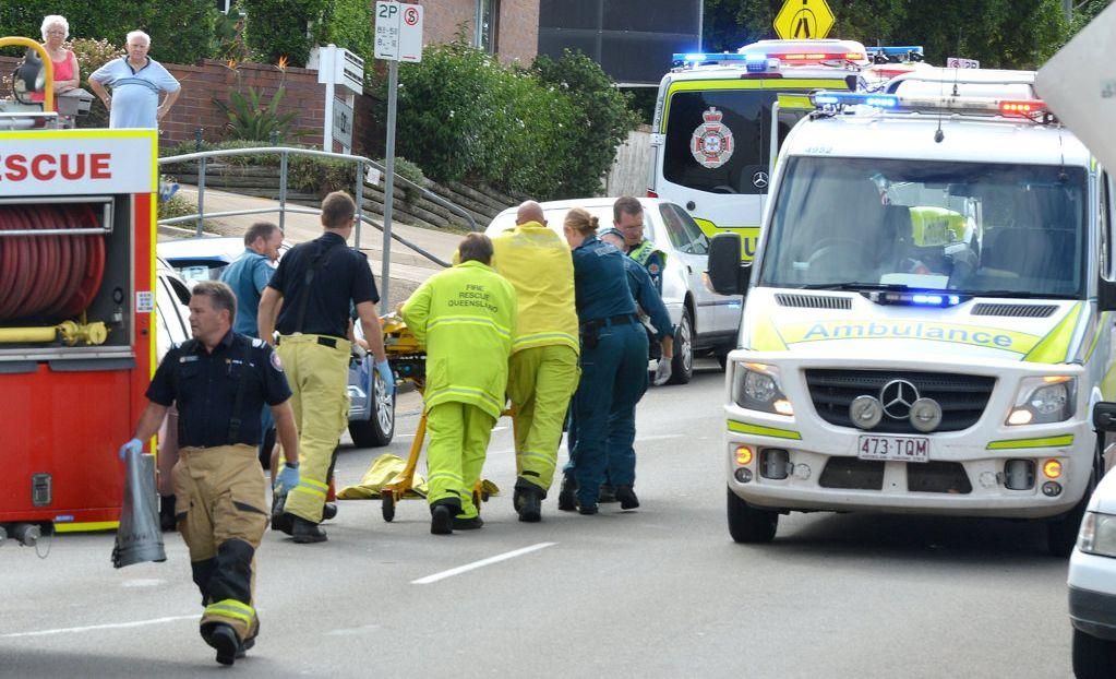 Paramedics rush the passenger to an ambulance following the crash on Nash St.