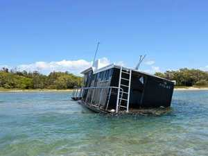 Residents rejoice as sinking houseboat heads to scrap heap