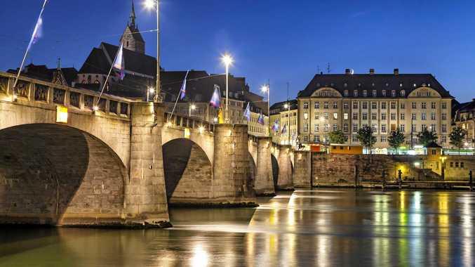 Mittlere bridge over the Rhine River at sunset in Basel, Switzerland.