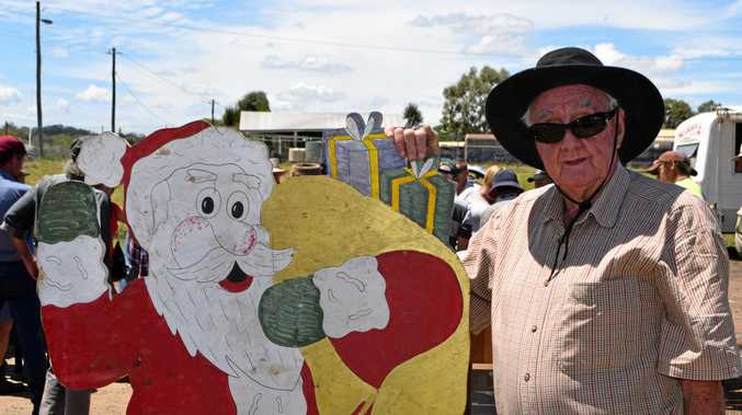 FESTIVE FIND: Bob Koina from Warwick said cooler weather and a bargain Santa made his time at the Pig and Calf Sale a great morning out.