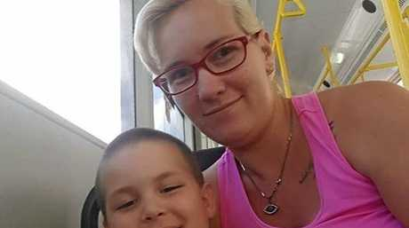 BIG LOVE: Mother and son Tori and Travis Brooks enjoying a ride on the bus and time together.
