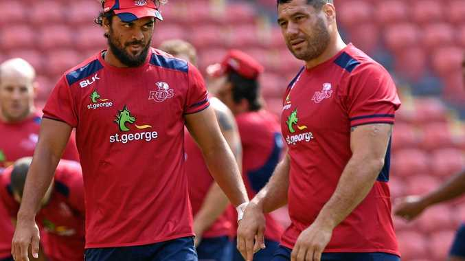 Karmichael Hunt (left) and George Smith are seen during the Queensland Reds captains run at Suncorp Stadium on Thursday.
