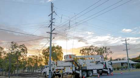 Ergon Energy workers repair damaged power lines in the Lakes Creek area after a fault caused multiple fires.