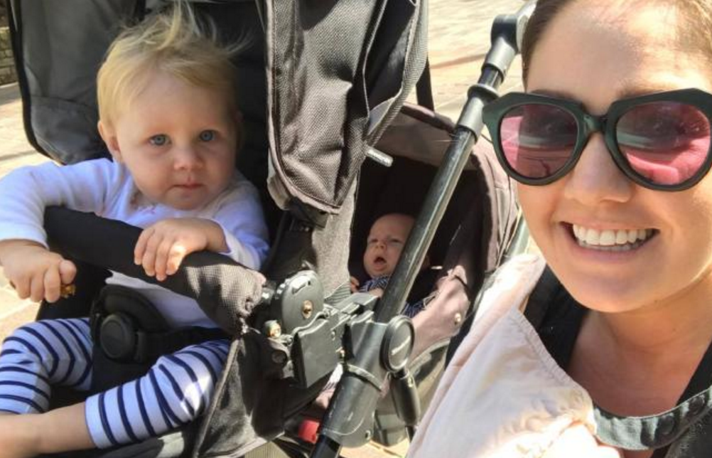 Eliza out and about with her three kids.
