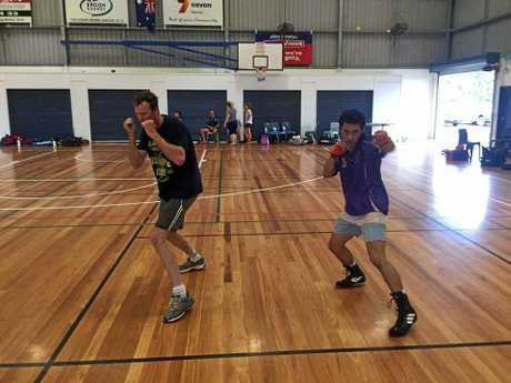 Mackay PCYC Boxing Club's Steve Dury and Lumikie Walker practicing at the development camp at the weekend.